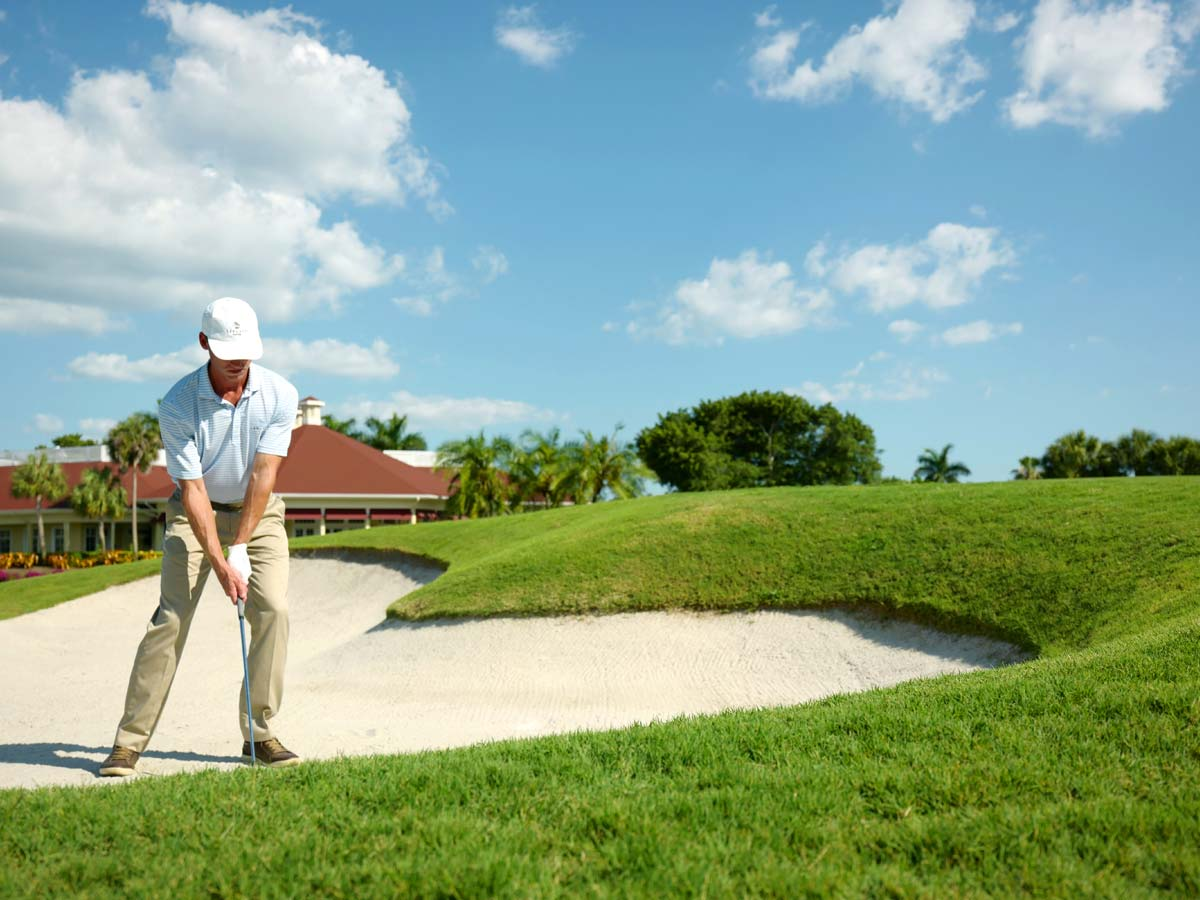 Golfer in sand trap at Naples Florida Golf Resort